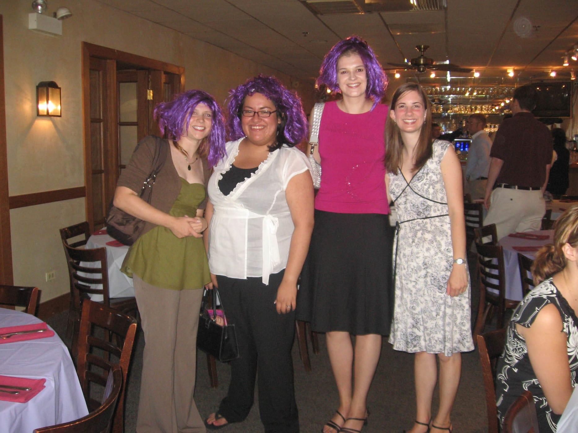 Bridesmaids in purple wigs.