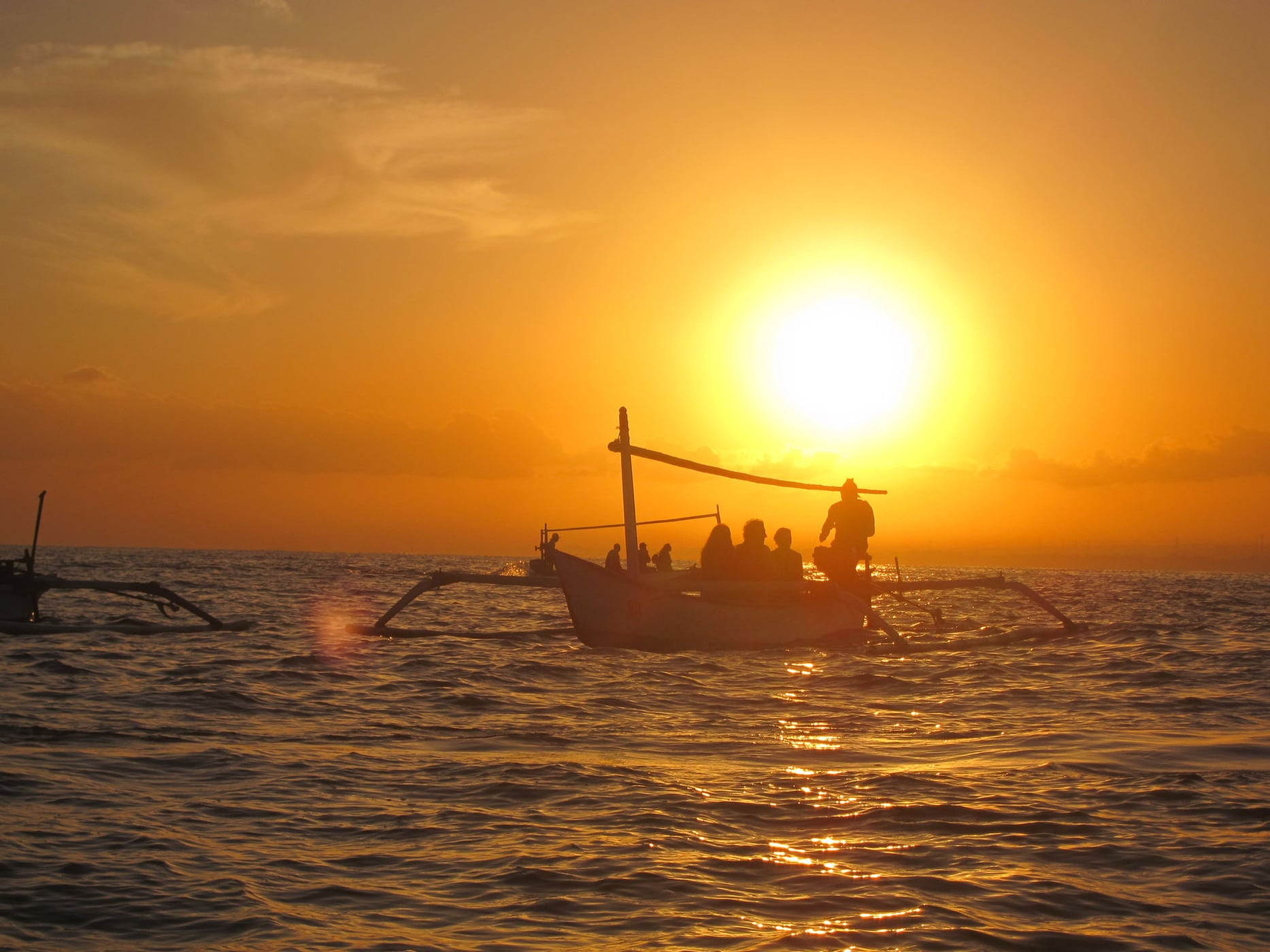 Sunrise dolphin watching in Lovina, Bali.