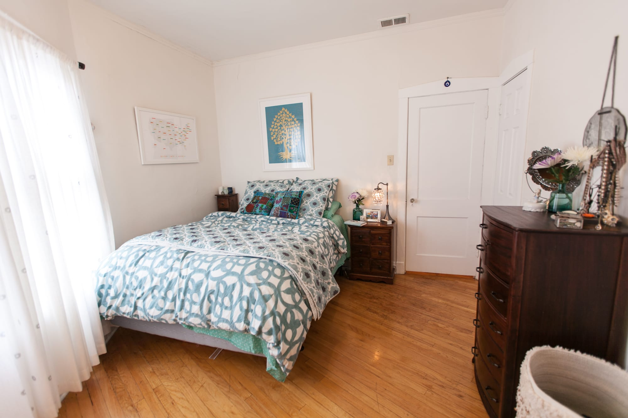 White and teal boho bedroom.