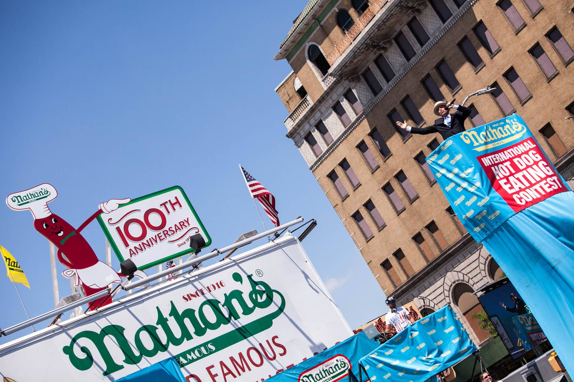George Shea introduced the Nathan's Famous hot dog eating contest at the 100th anniversary.