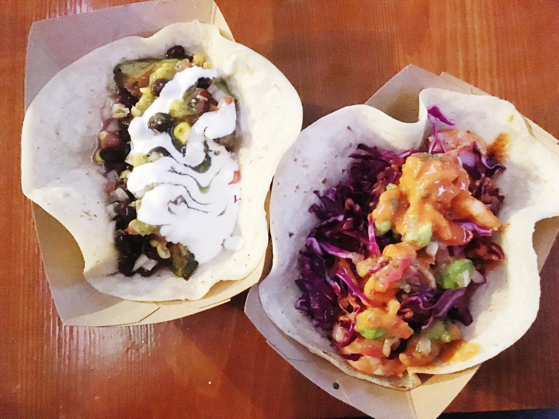 The Mighty Mo (garlic lime shrimp taco) and a fried avocado taco at The Violet Taco in Austin, Texas.