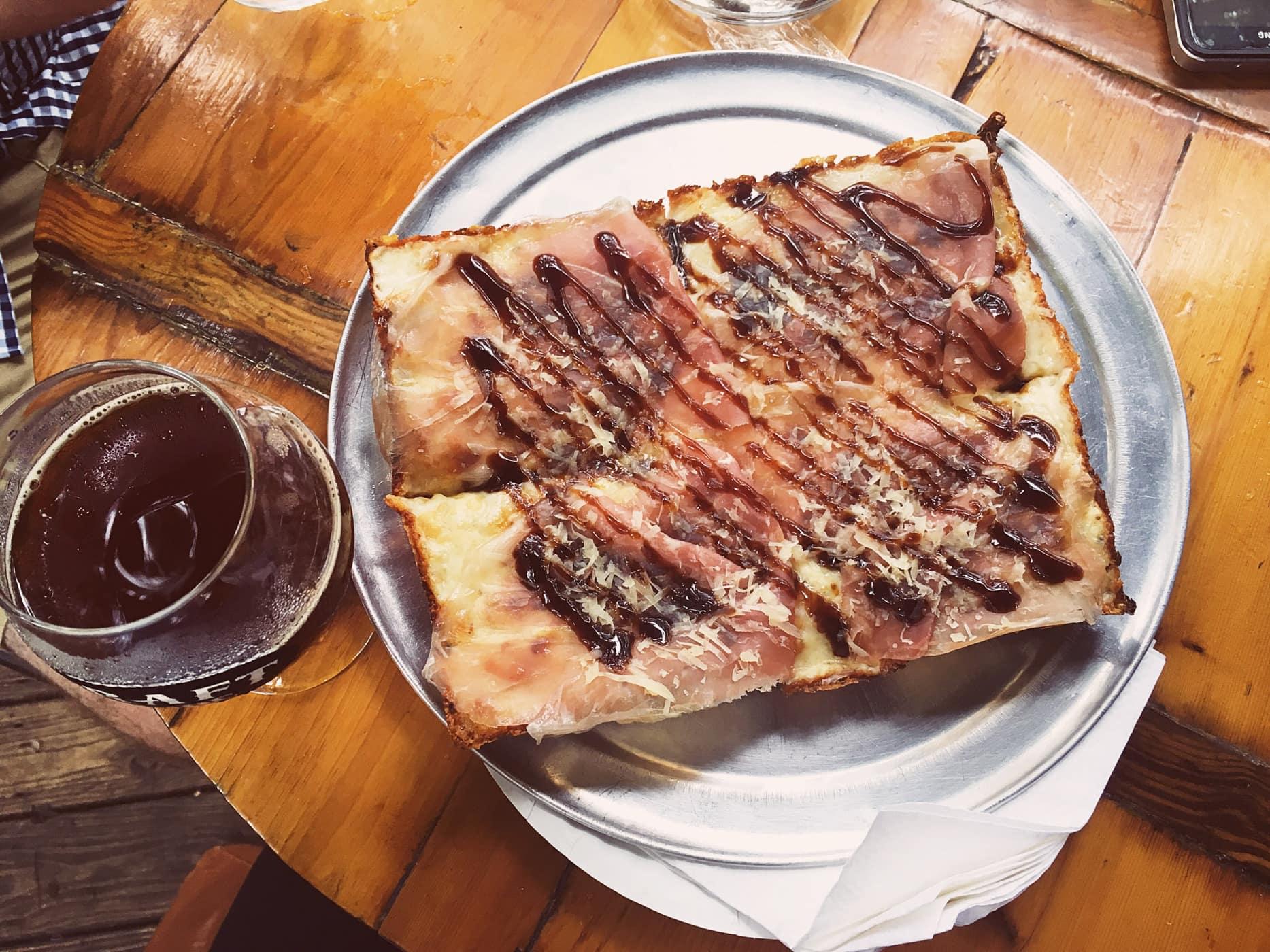 The Cadillac pizza (Gorgonzola, Fig Preserves, Prosciutto di Parma, Parmesan, Balsamic Glaze) at Via 313 in Austin, Texas.