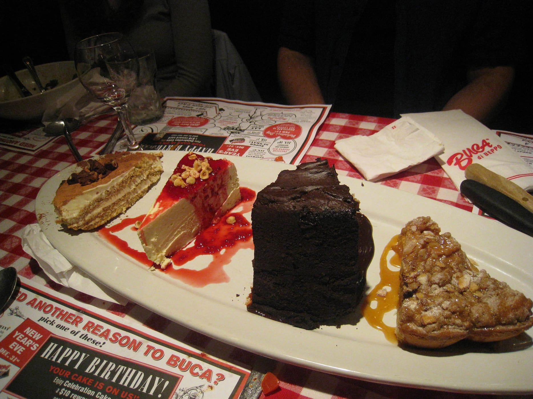 Dessert platter of Tiramisu, Double Dark Chocolate Cake, Homemade Cheesecake, and Apple Crostata at Bucca di Beppo