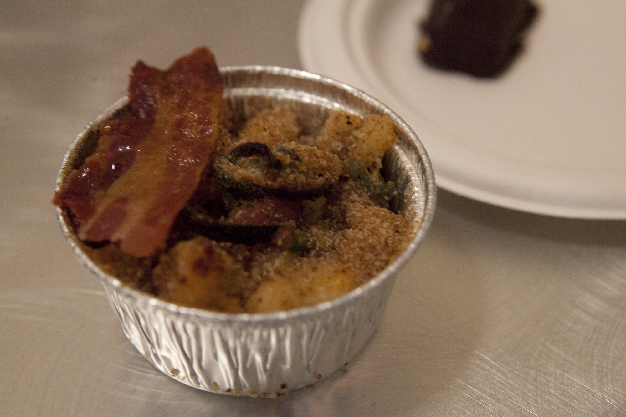 Hominy with bacon, pork belly, jalapeno, and cheddar from Lula Cafe at Baconfest Chicago - a bacon festival