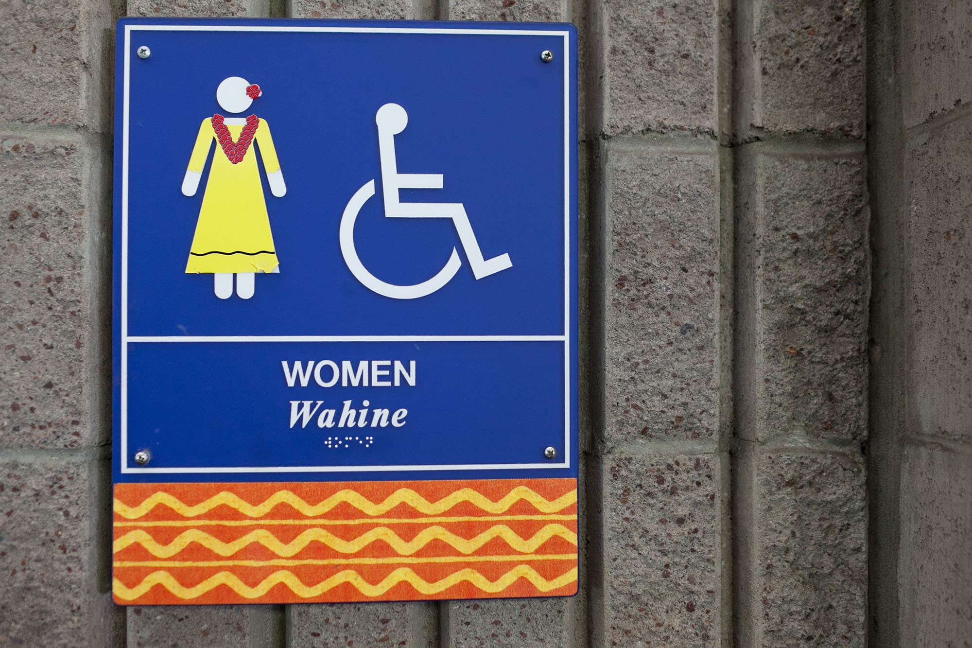 Wahine - women's bathroom sign at the airport in Hawaii