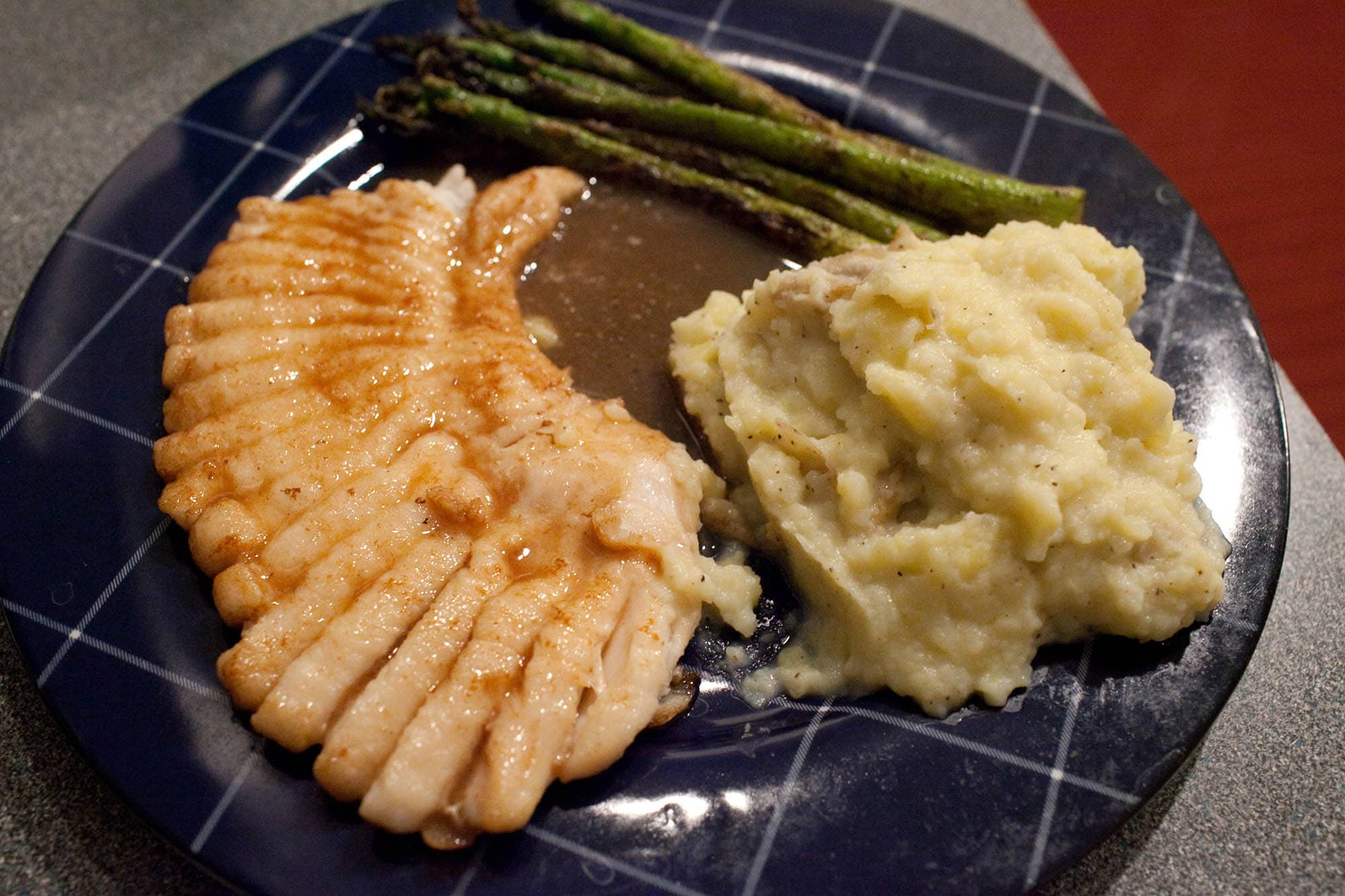 Skate wing with mashed potatoes and asparagus.