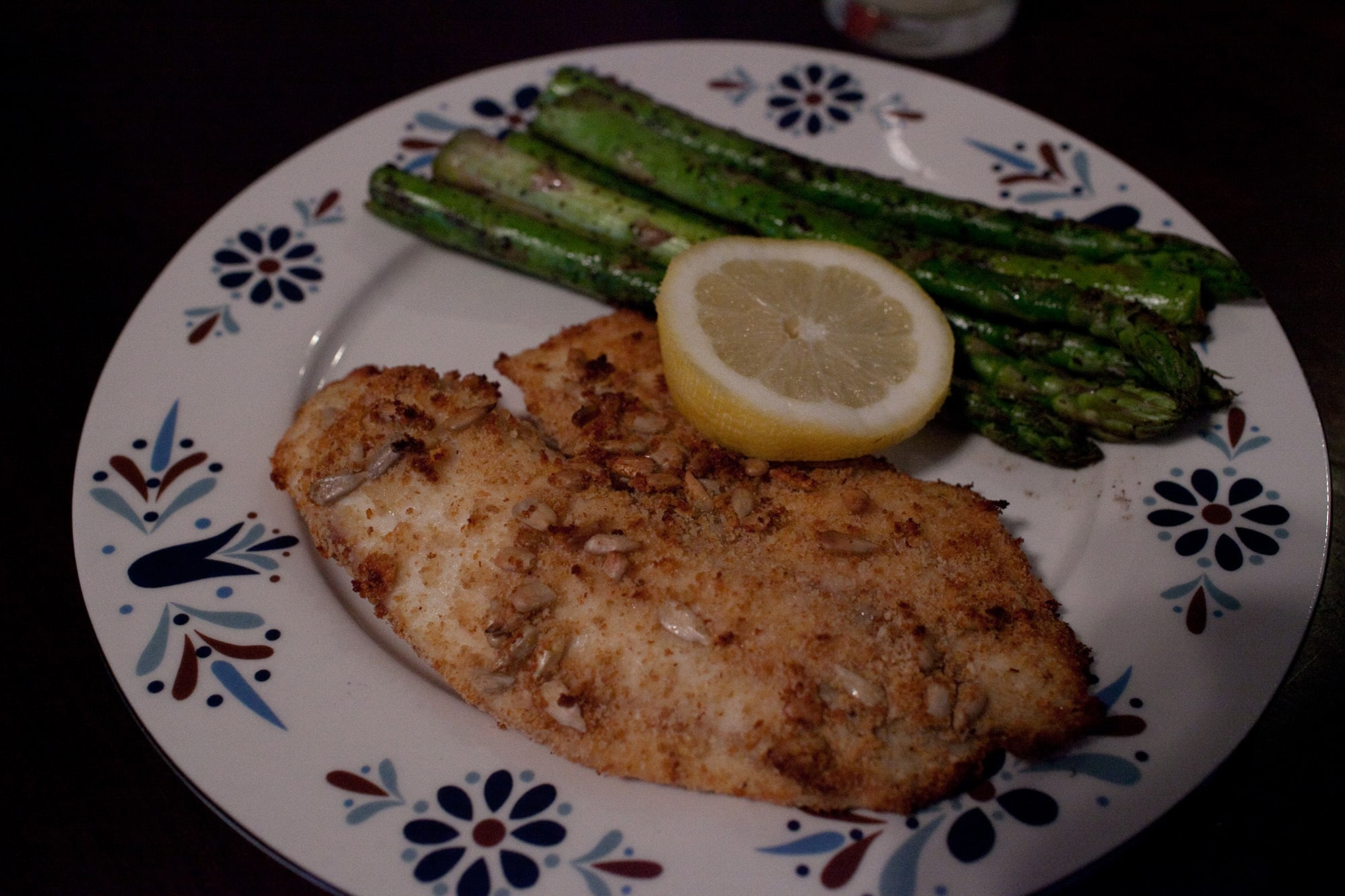 Sunflower seed crusted tilapia with asparagus.