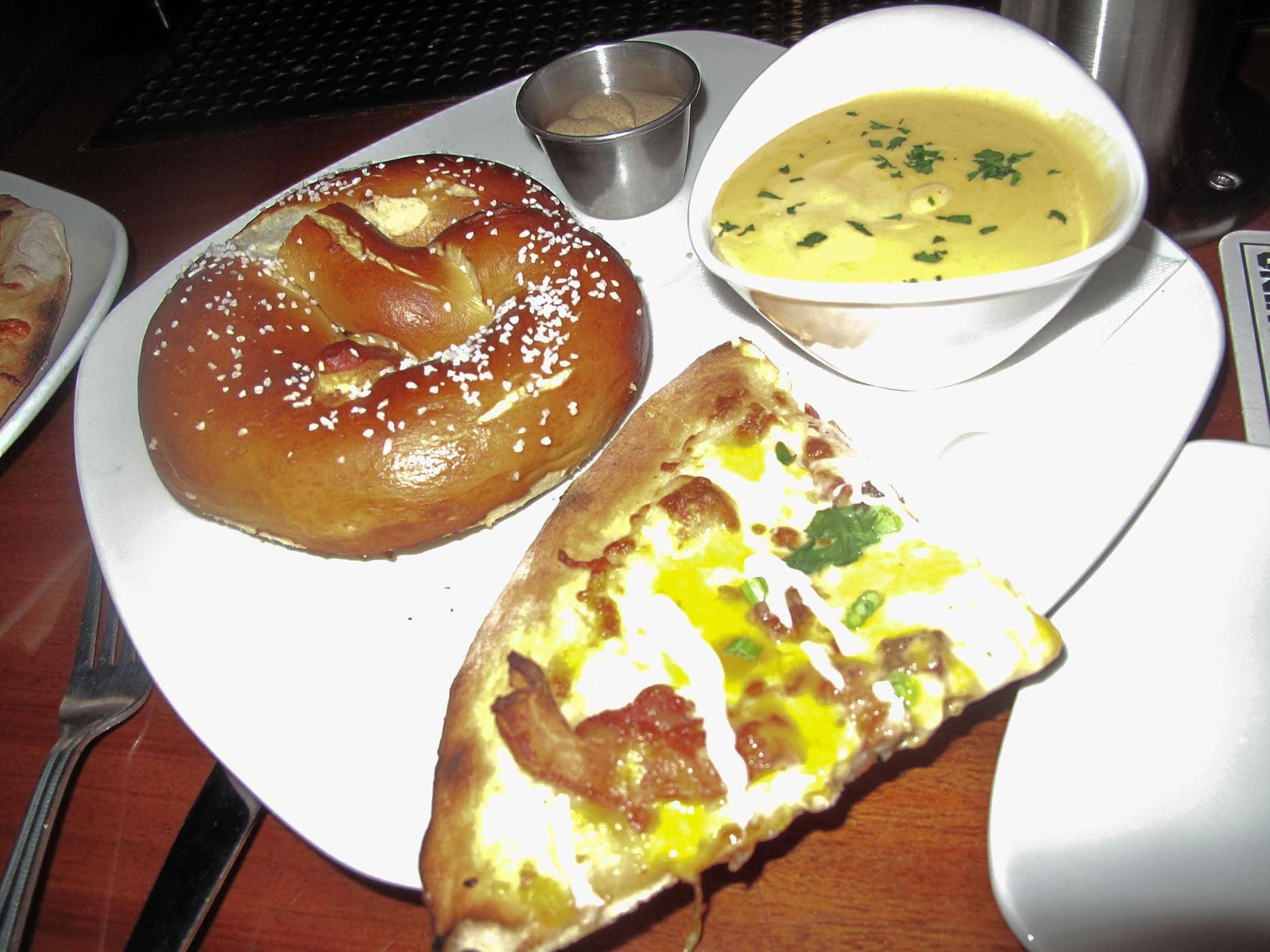 Twice baked potato pizza and a pretzel at Revolution Brewing in Chicago.