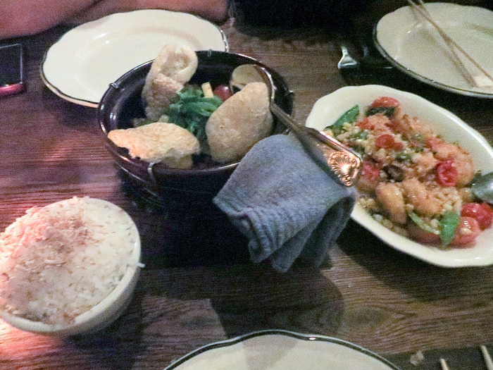 Shrimp and Corn, pork belly, and coconut rice at Fat Rice in Chicago, Illinois