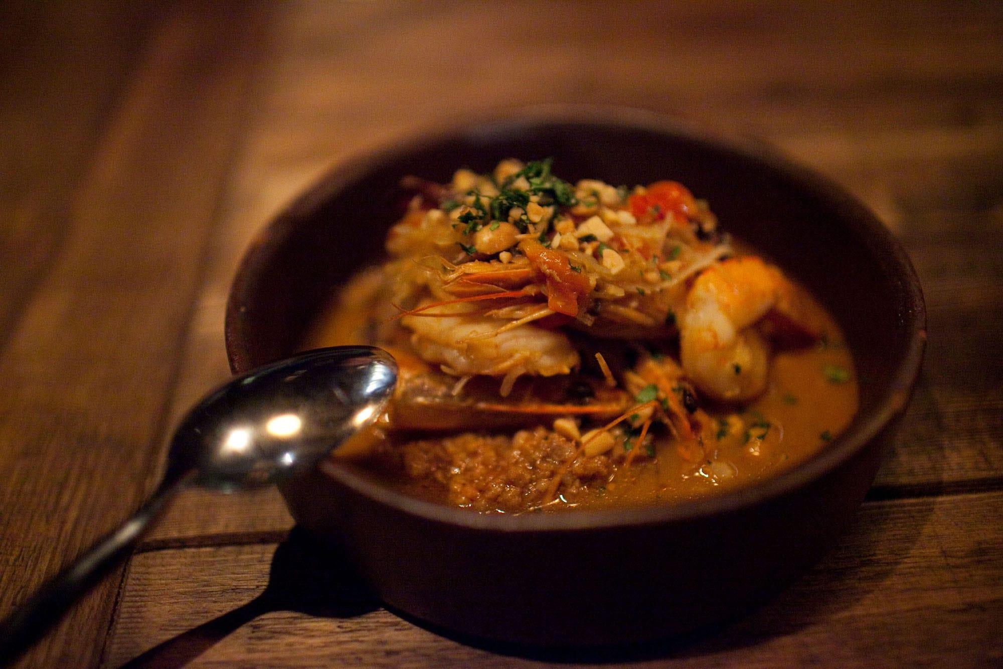 Girl and the Goat - Sauteed shrimp with peanut pork ragu, shiitake, and spaghetti squash.