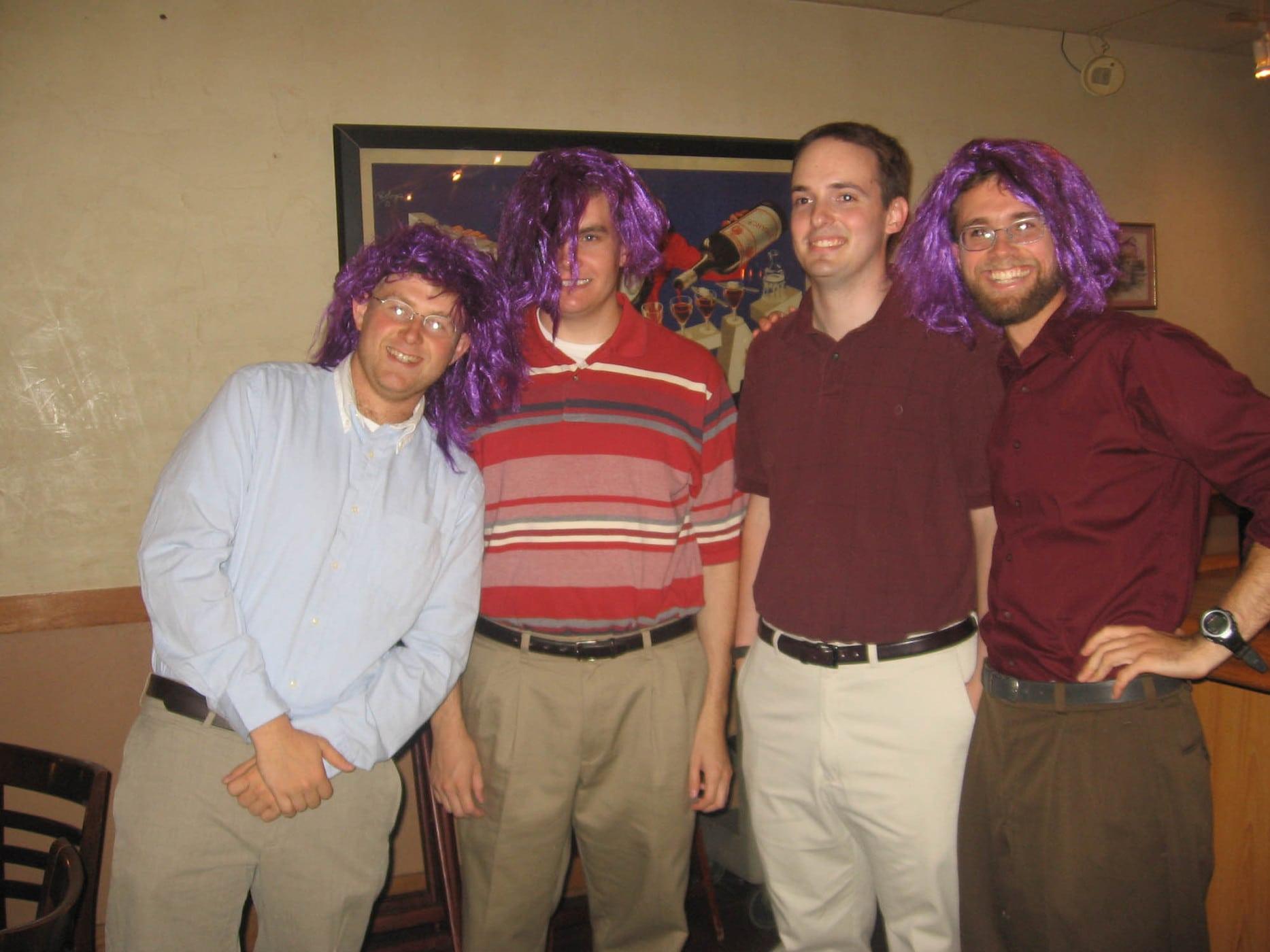 groomsmen in purple wigs