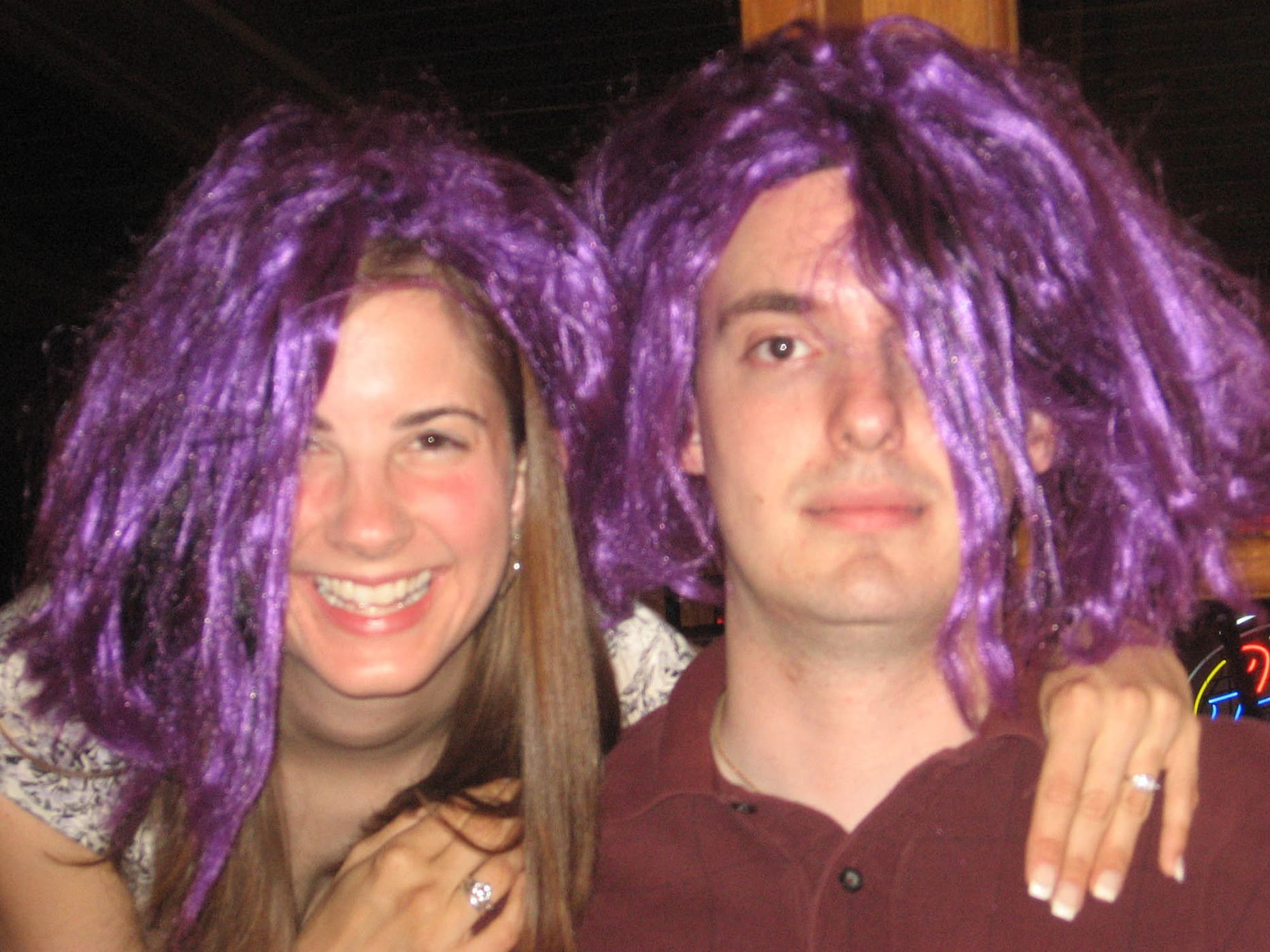 the bride and groom in purple wigs