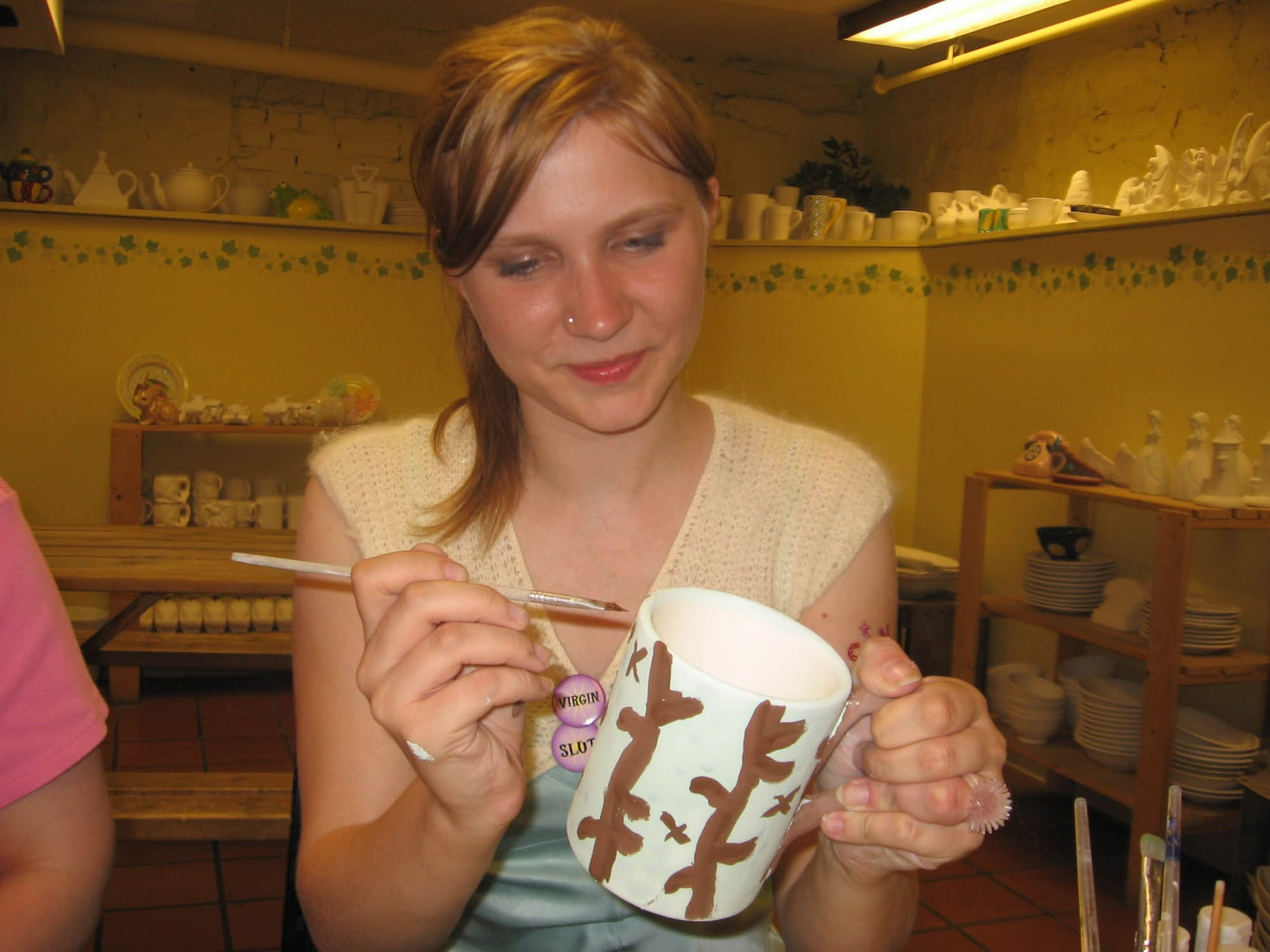 Painting a mug at a paint your own pottery place