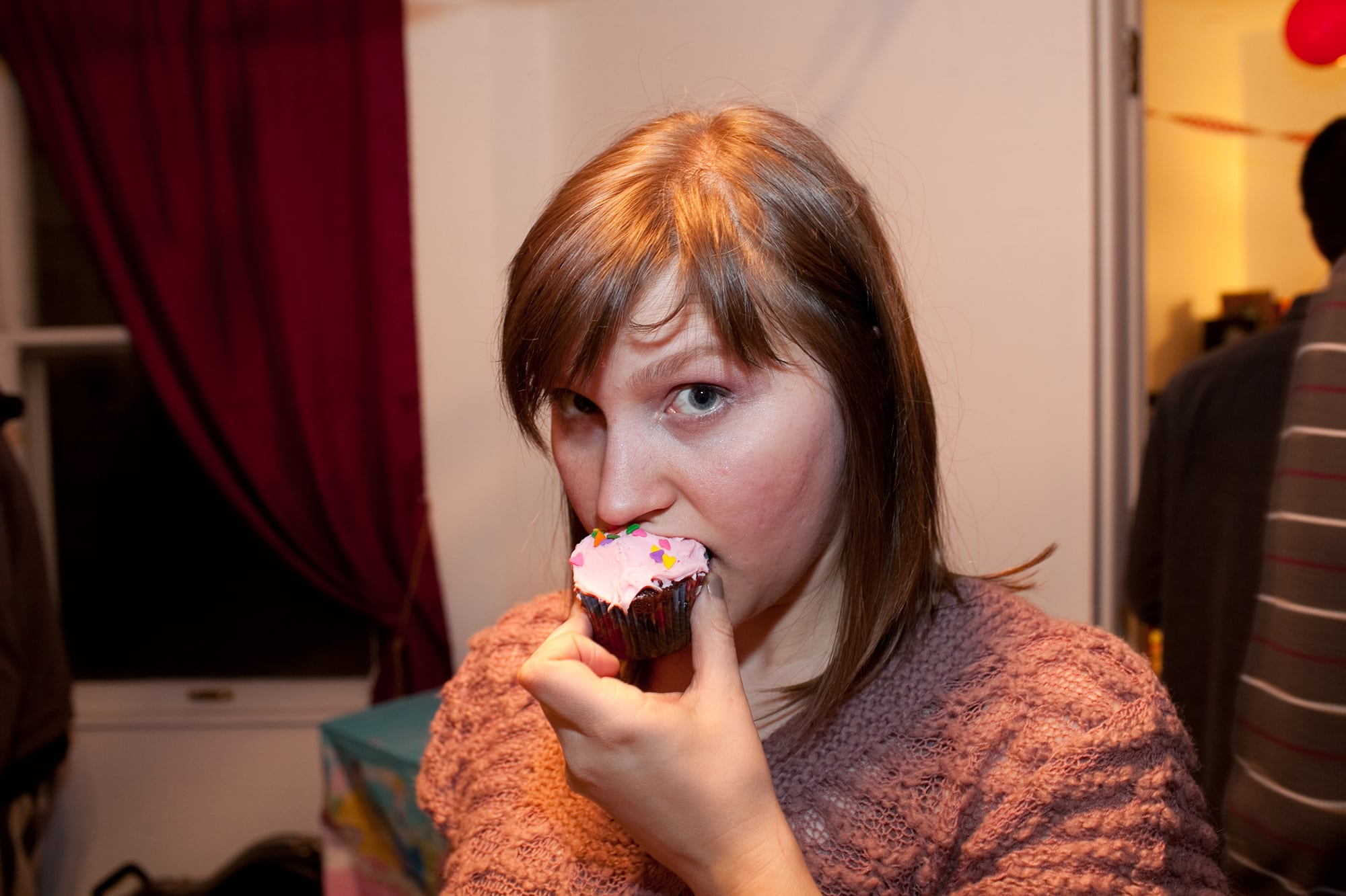 My thirtieth birthday party. I eat a birthday cupcake.