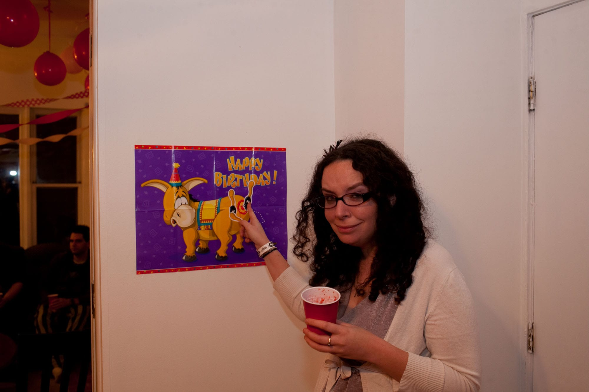 My thirtieth birthday party. Playing pin the tail on the donkey.