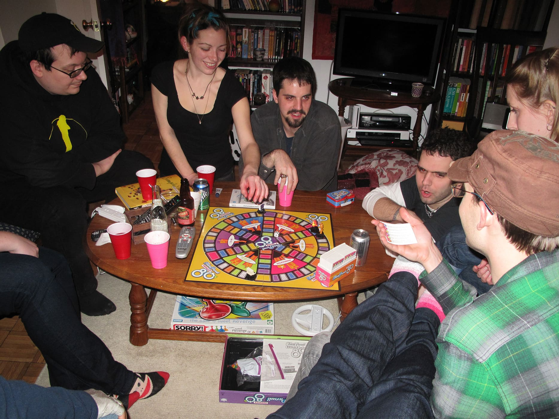 My thirtieth birthday party. Playing Totally 80s Trivial Pursuit.