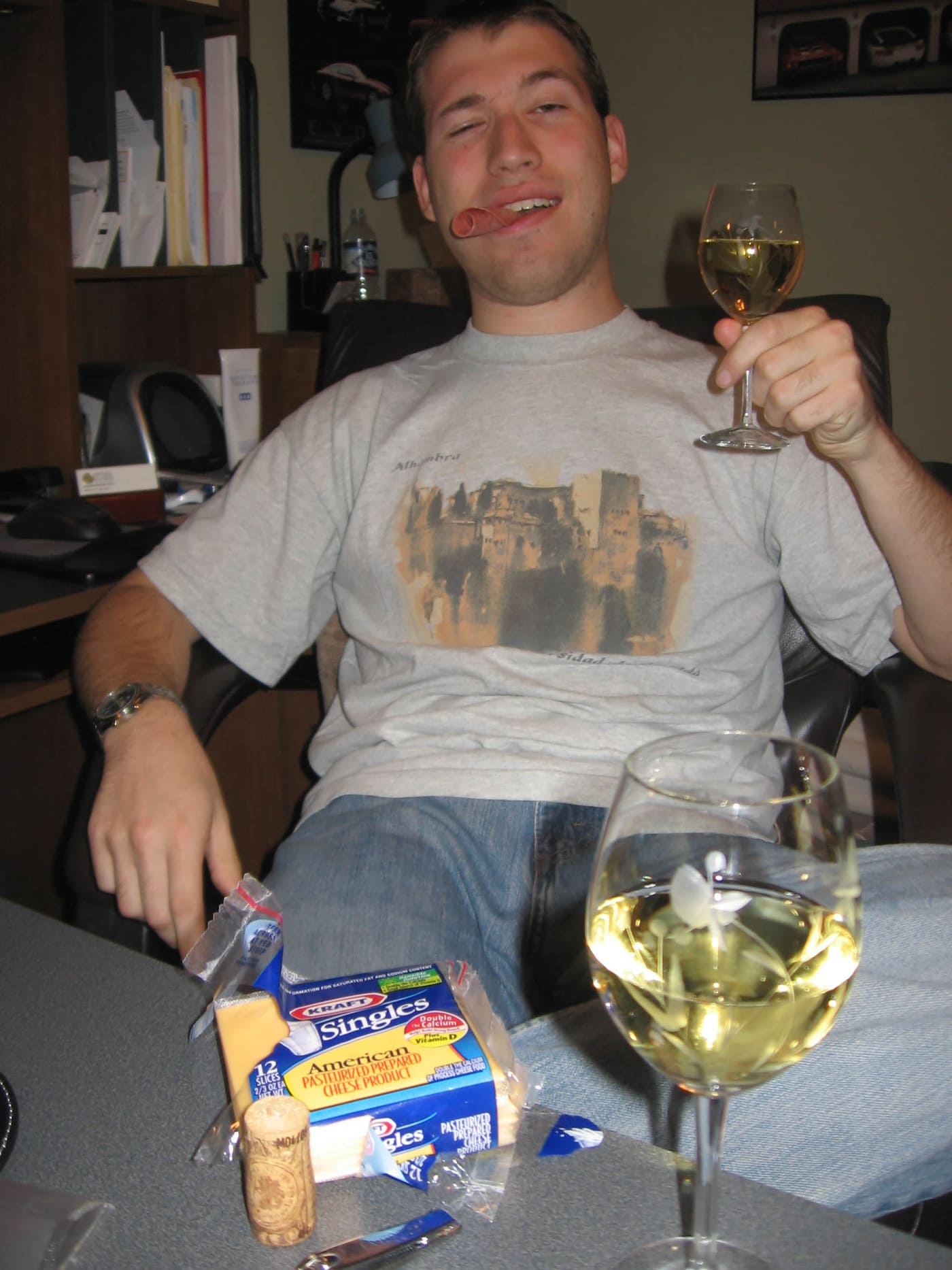 Matt with wine and lunchmeat