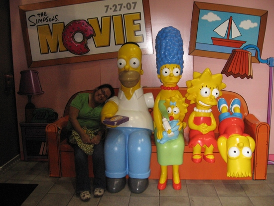 The Simpsons family on the couch movie promotion