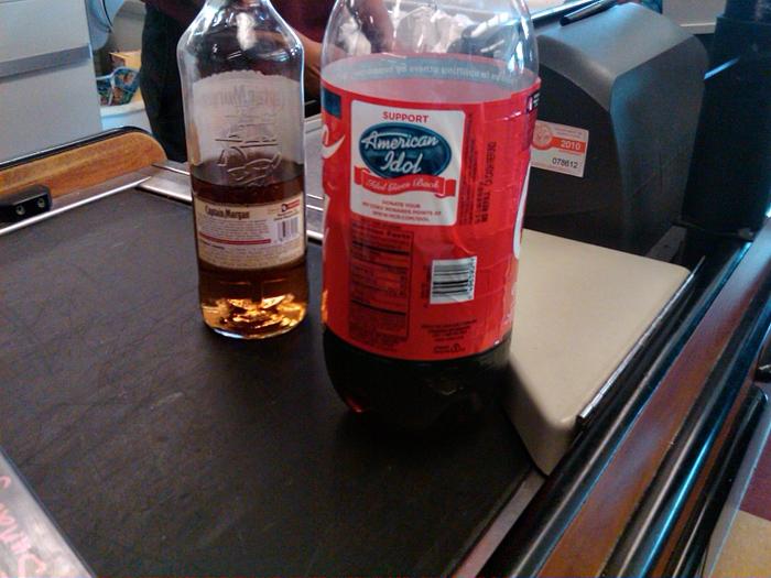 Half bottle of rum and coke
