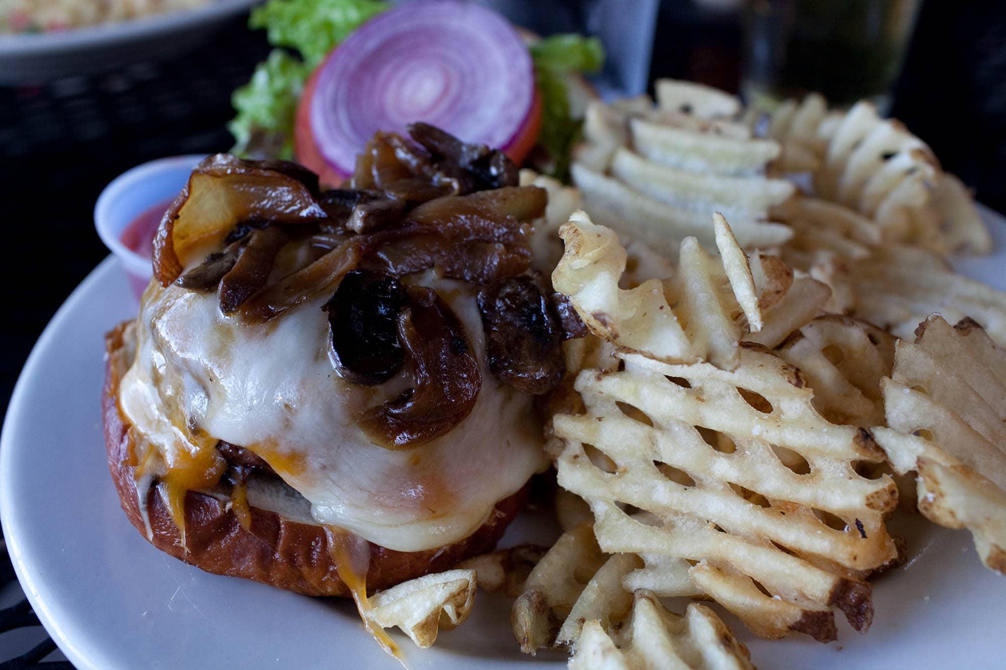 Kuma's Corner in Chicago, Illinois - Neurosis burger with cheddar, swiss, sautéed mushrooms, caramelized onions, and horseradish mayo