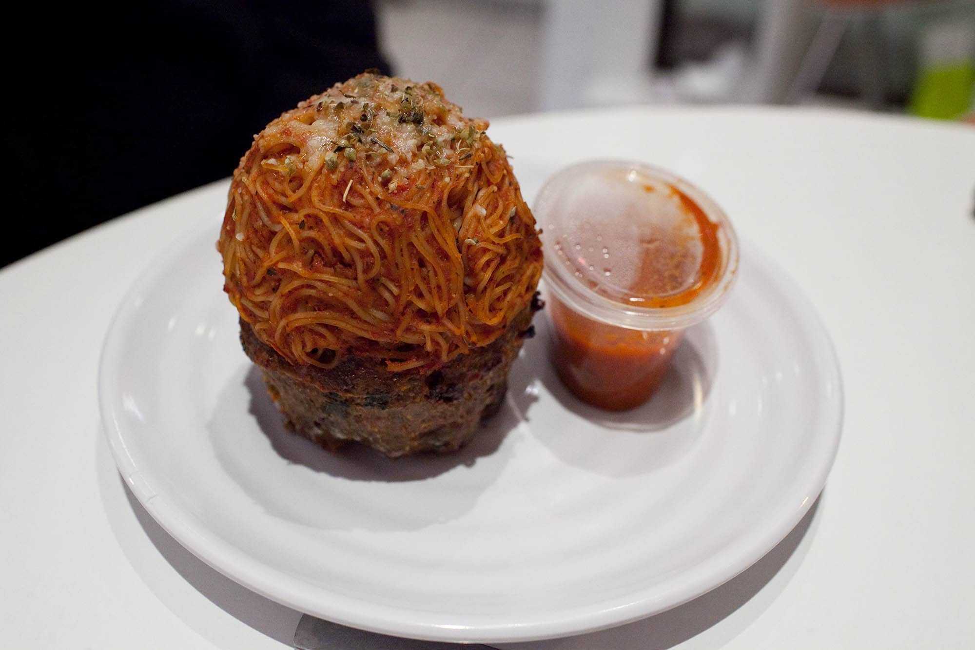 The Meatloaf Bakery in Chicago - Loaf-a-Roma Meatloaf Cupcake - beef and Italian sausage with mozzarella cheese, sun dried tomatoes, basil and red wine topped with angel hair pasta and served with marinara sauce.