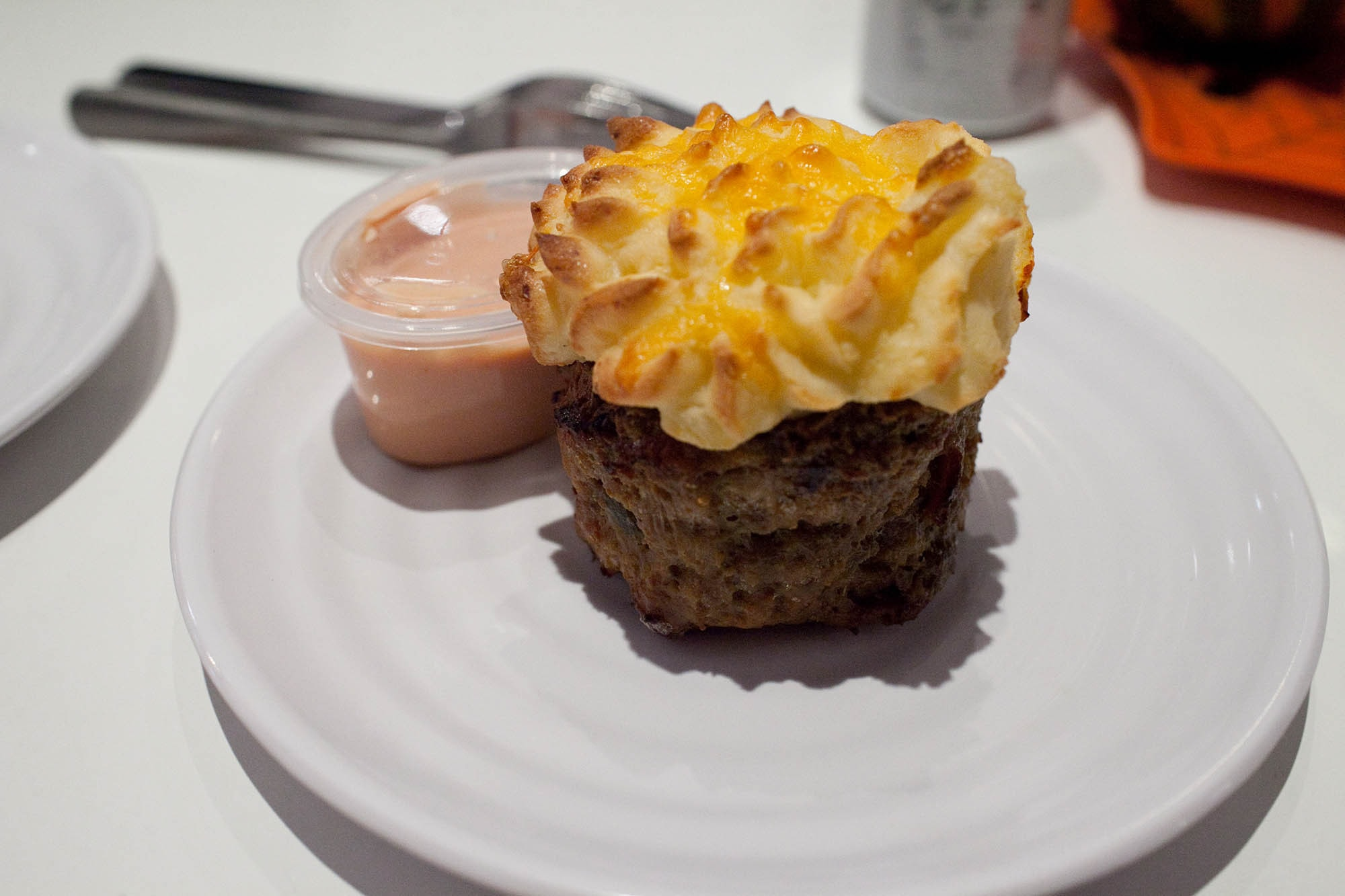 The Meatloaf Bakery in Chicago - No Buns About It Meatloaf Cupcake - beef with bacon, cheddar, onions, mustard, ketchup, and pickles topped with cheesy taters and served with special sauce.