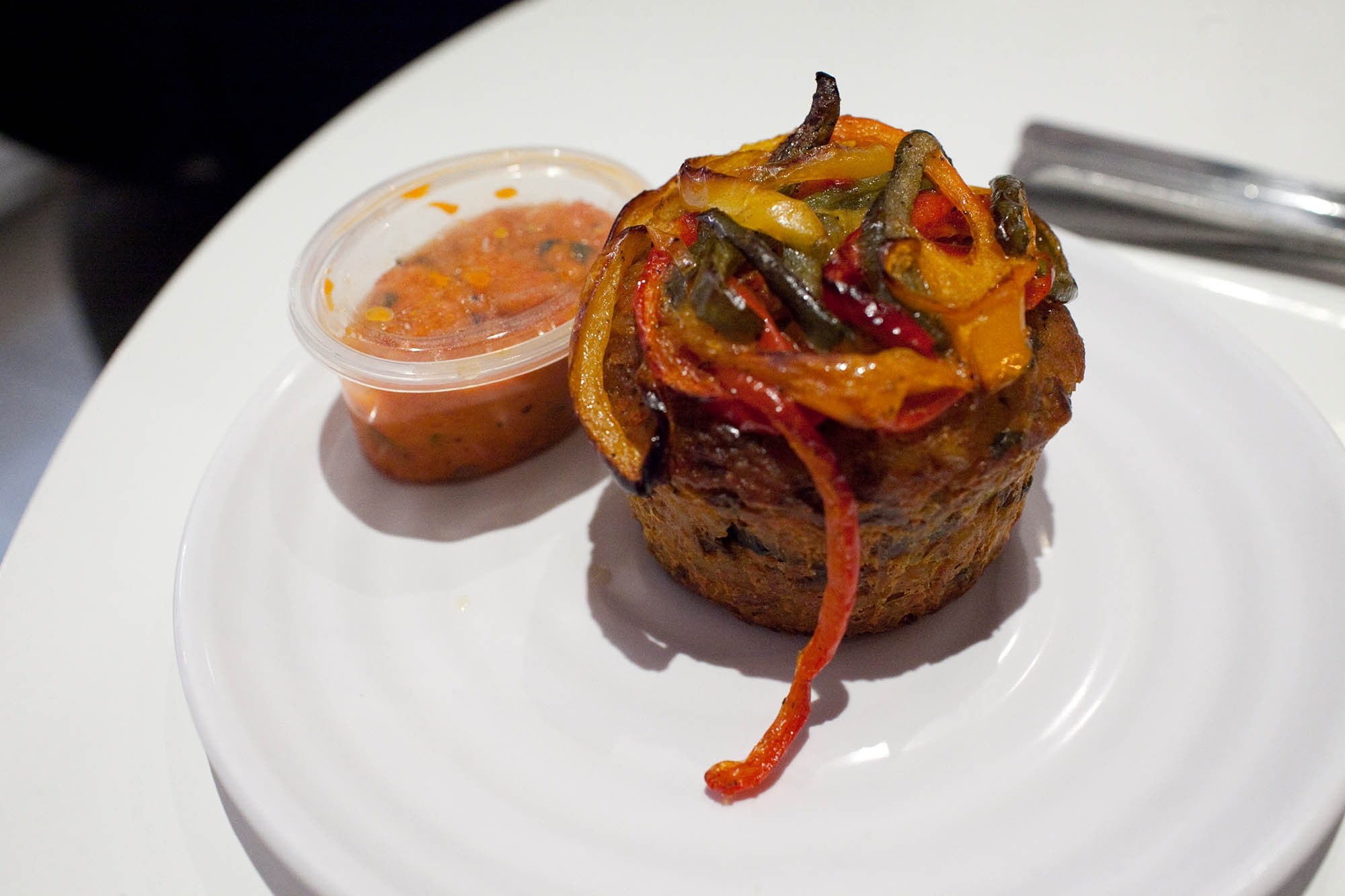 The Meatloaf Bakery in Chicago - Yentl Lentl Meatloaf Cupcake - lentils, brown rice, vegetables, and cheese topped with bell peppers and served with roasted red bell pepper coulis