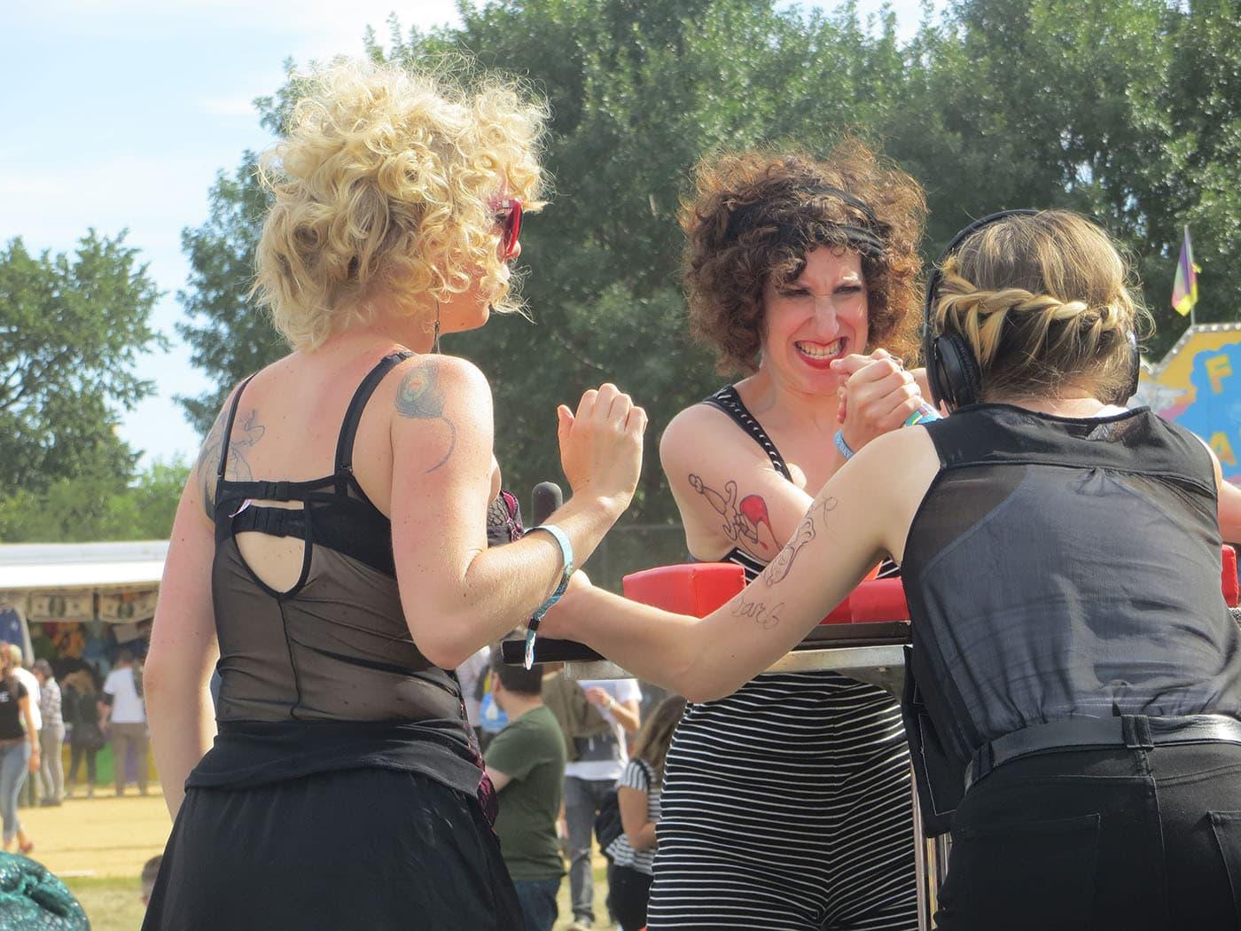 Lady arm wrestling at Riot Fest Chicago 2013