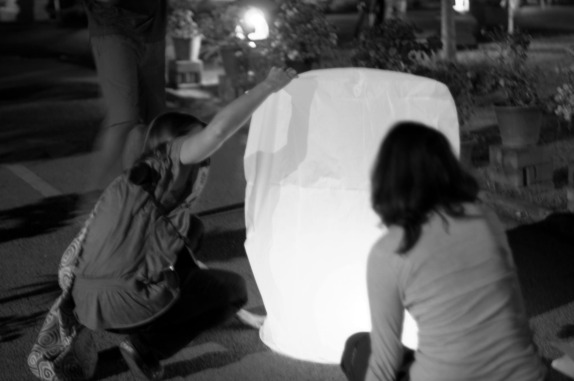 Lighting paper lanterns in Chiang Mai, Thailand.