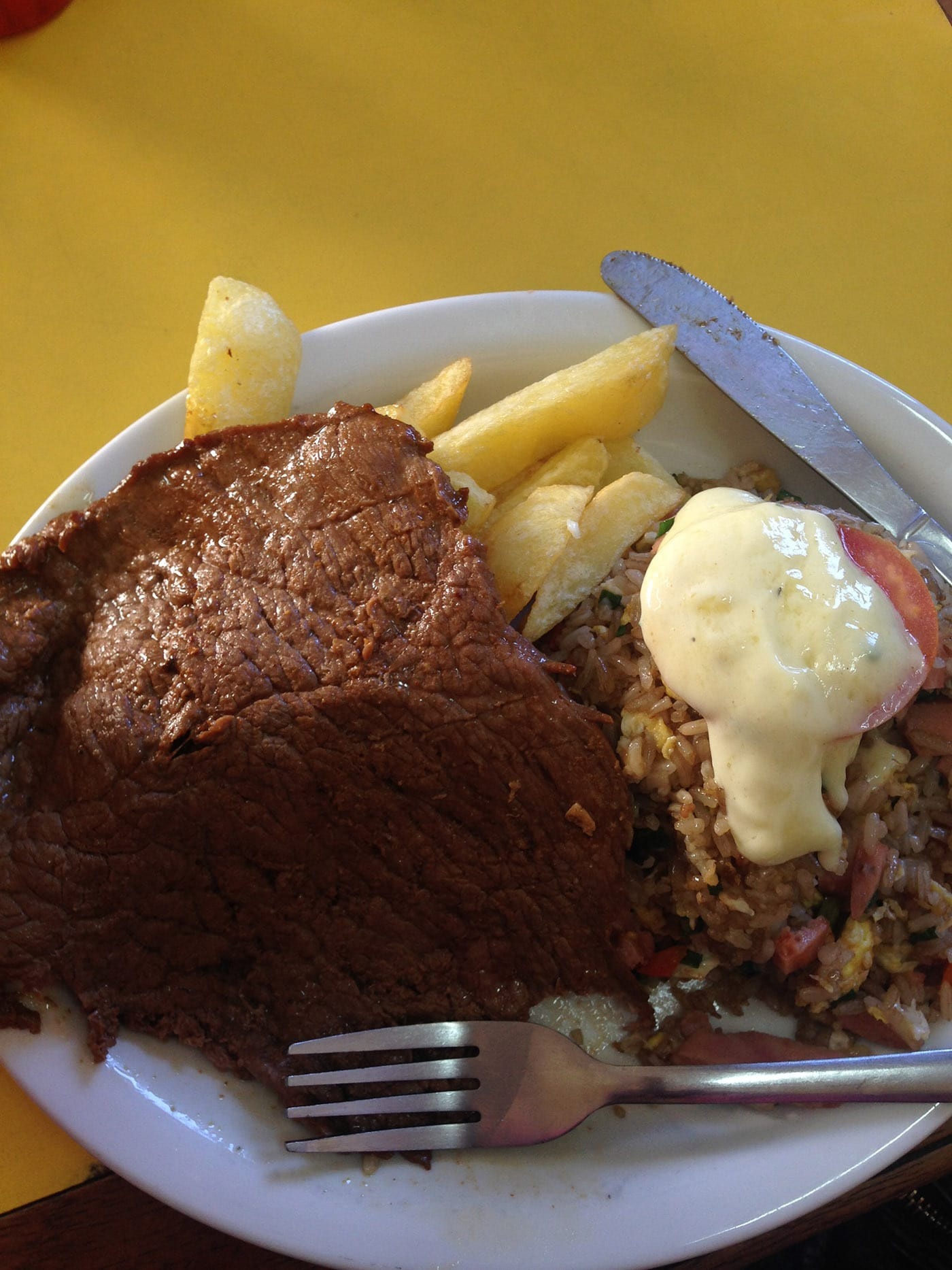 Beef with fried rice and fries in Cusco, Peru. What to eat in Cusco, Peru.