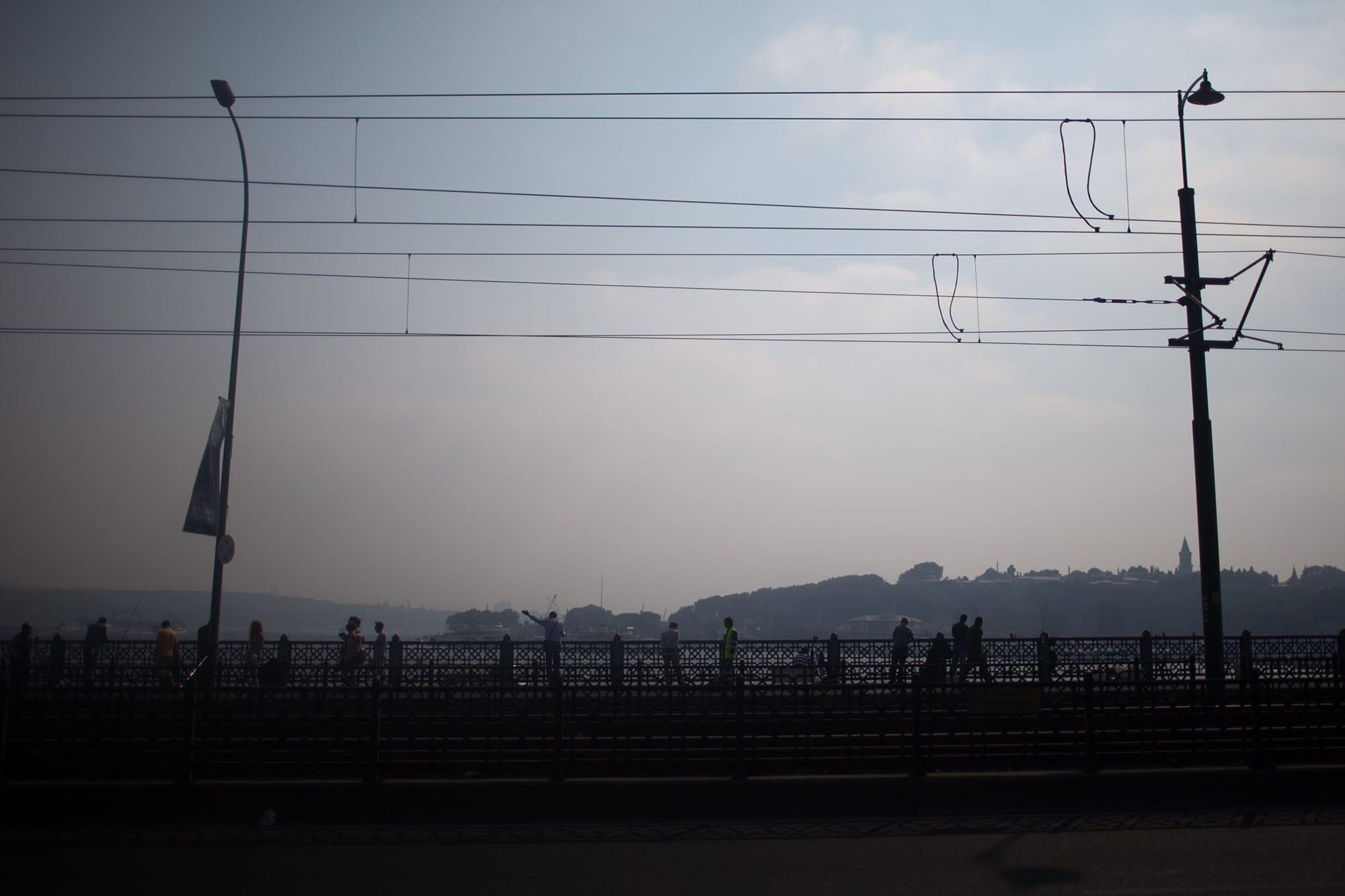 Fishing on the Galata Bridge in Istanbul, Turkey.