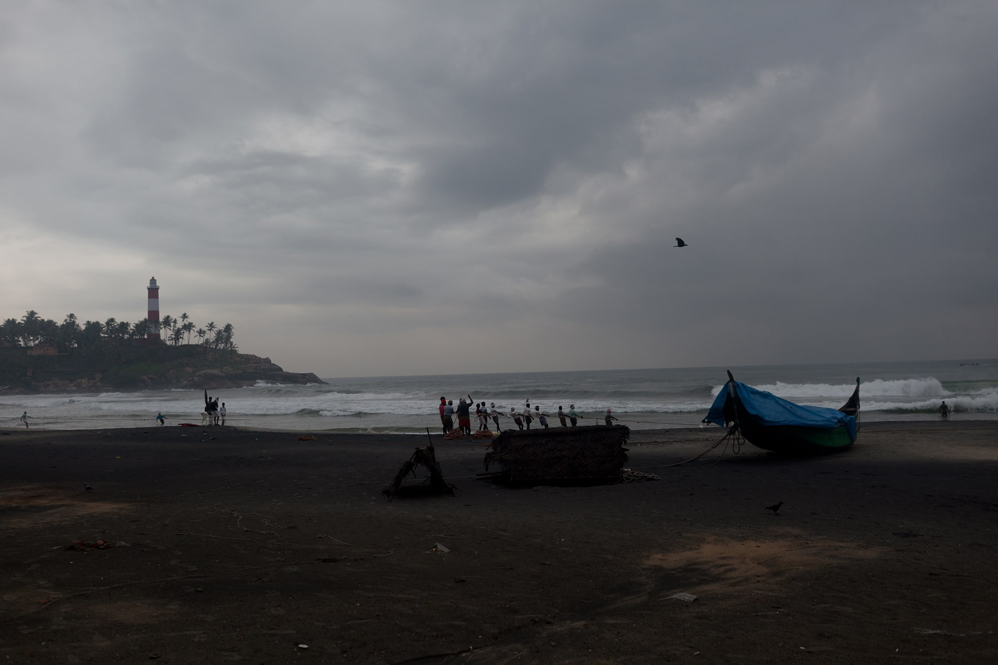 Fishermen on the beach in Kovalam, India