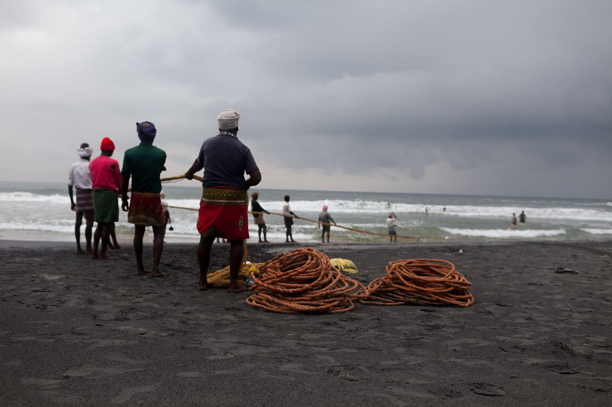 Fishermen on the beach in Kovalam, India