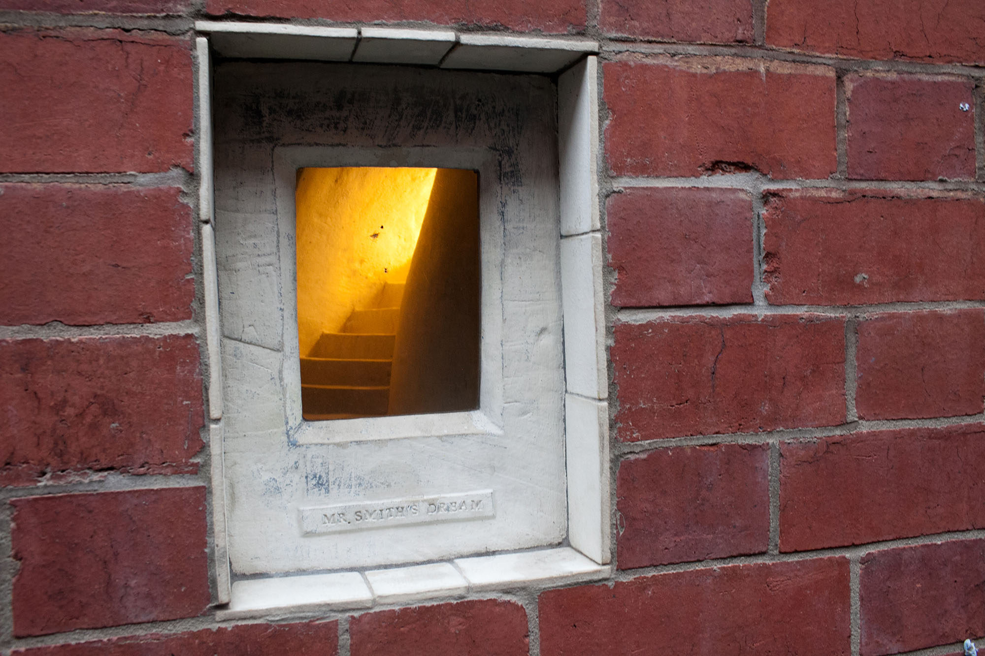 Mr Smith's Dream - tiny window and staircase in Manchester, England.