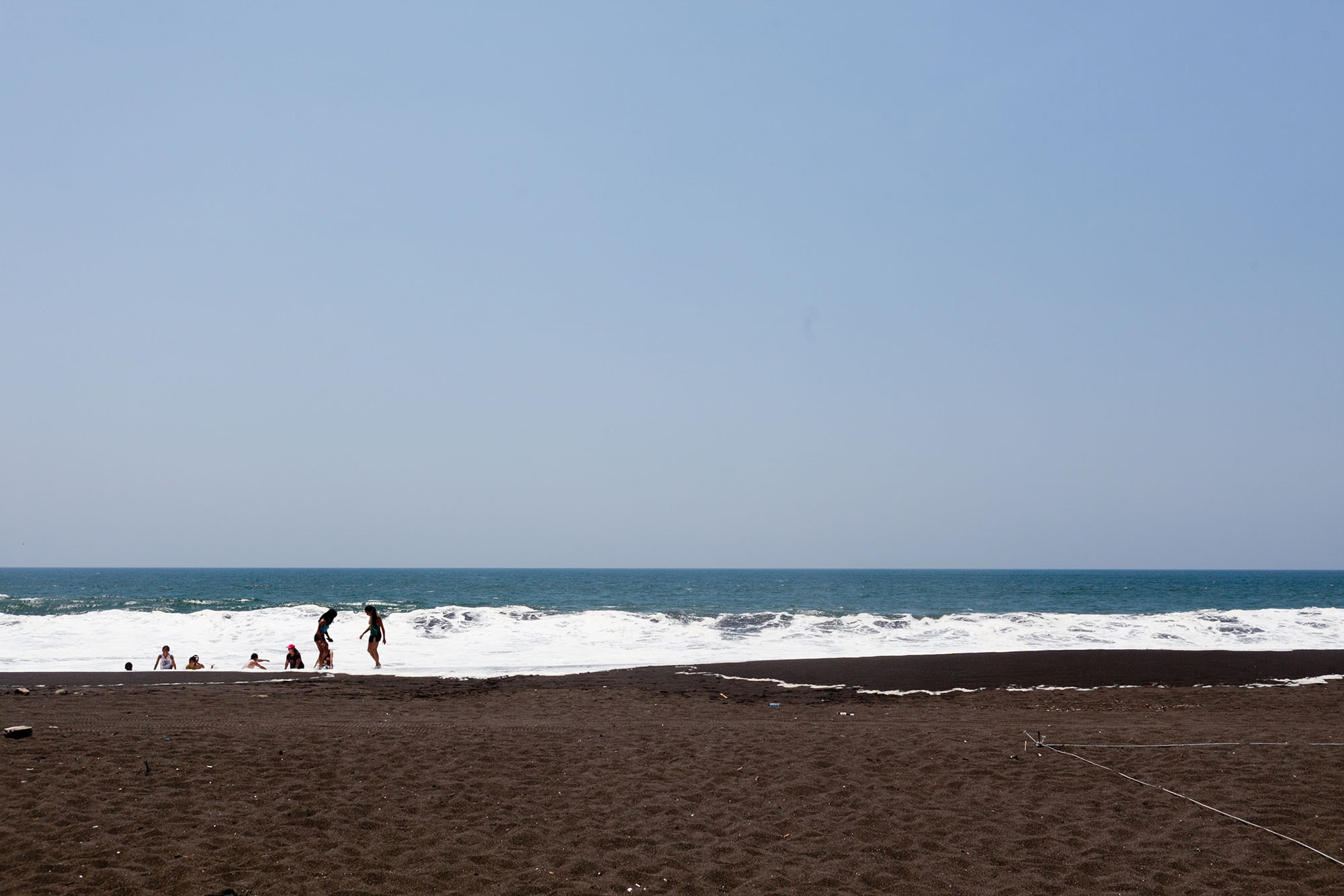 Volcanic black sand beach at Monterrico Beach in Guatemala