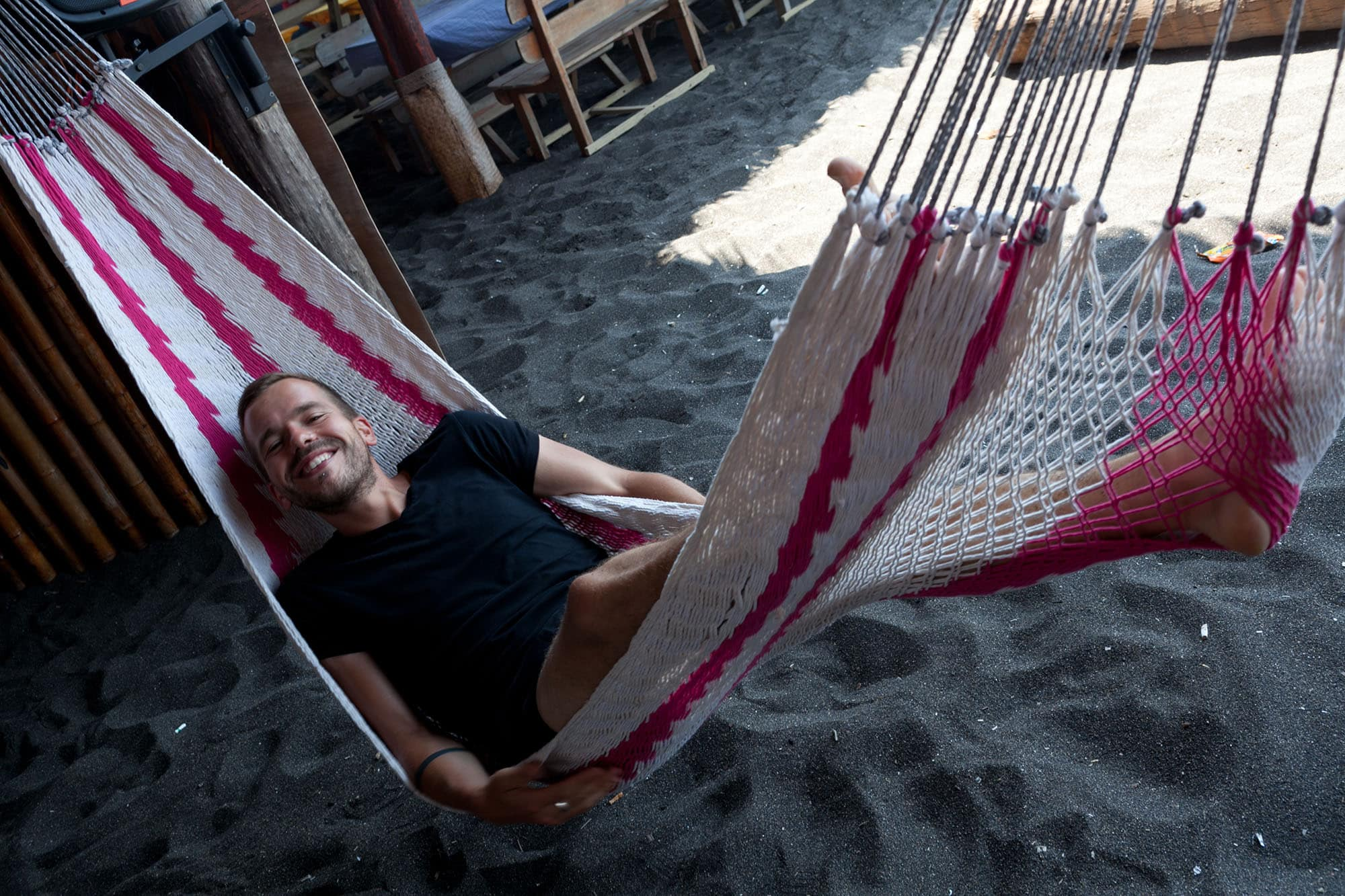 Lying in hammocks at Monterrico Beach in Guatemala