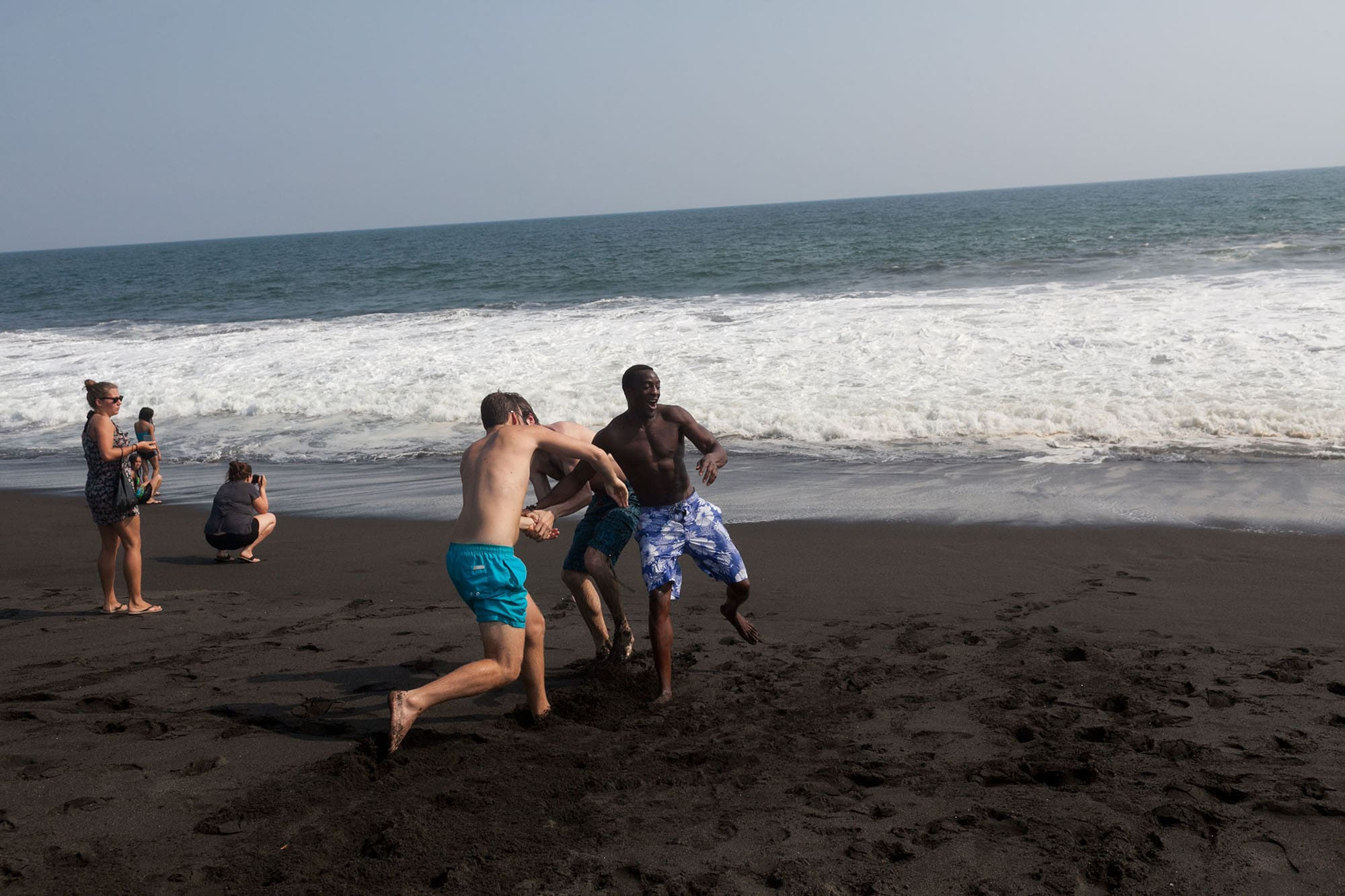 Playing in the black sand at Monterrico Beach in Guatemala