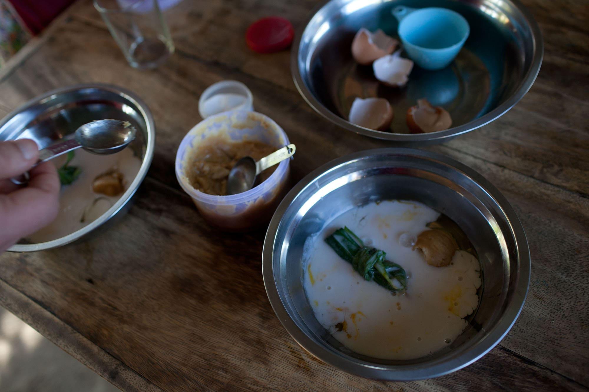 Making Pumpkin Custard at Sammy's Organic Thai Cooking School in Chiang Mai, Thailand.