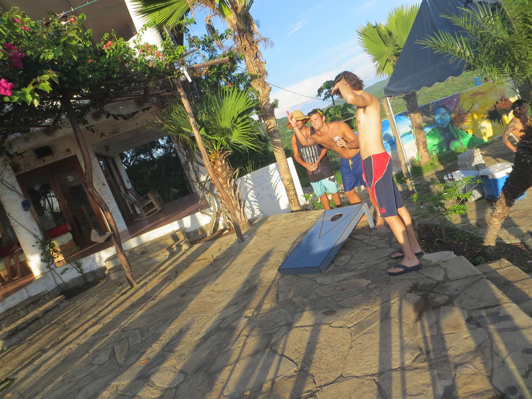 Playing bags at the Sunday Funday Pool Crawl in San Juan Del Sur, Nicaragua