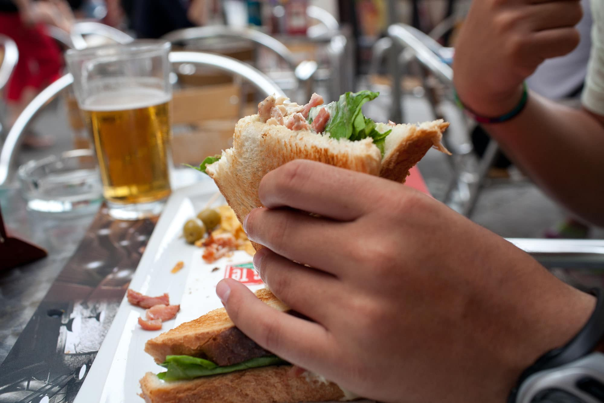 Jaime eats a sandwich in Valencia, Spain.