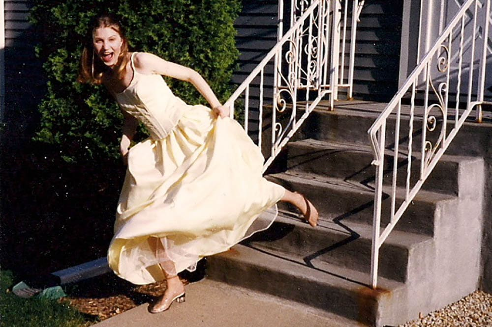 Dressed as Cinderella going to prom, loses her glass slipper