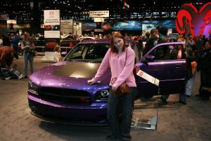 Val and a purple car at the Chicago Auto Show