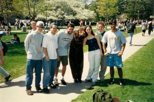 Val in a monkey costume with friends on the University of Illinois quad