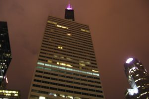The Sears Tower Lit up pink.
