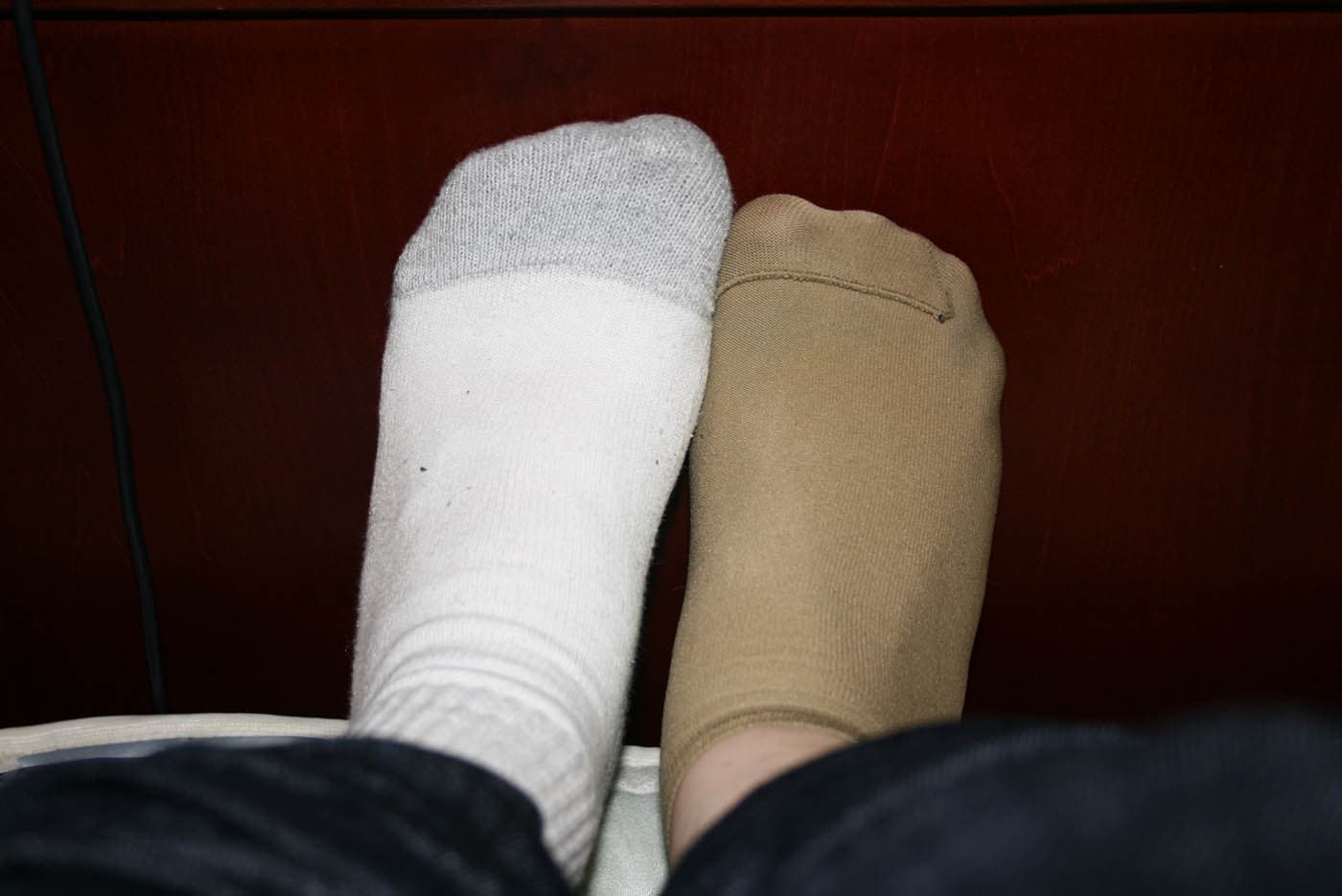 Accidentally wearing two different types of socks.