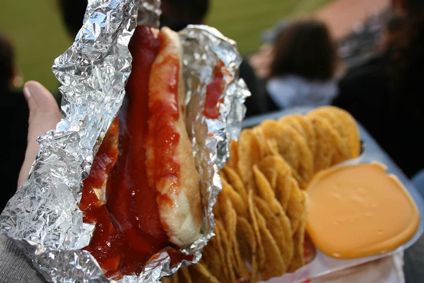 Ballpark hot dog smothered in ketchup at a White Sox game.