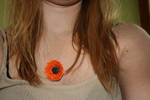 Sofia Masri porcelain orange flower necklace from Etsy.
