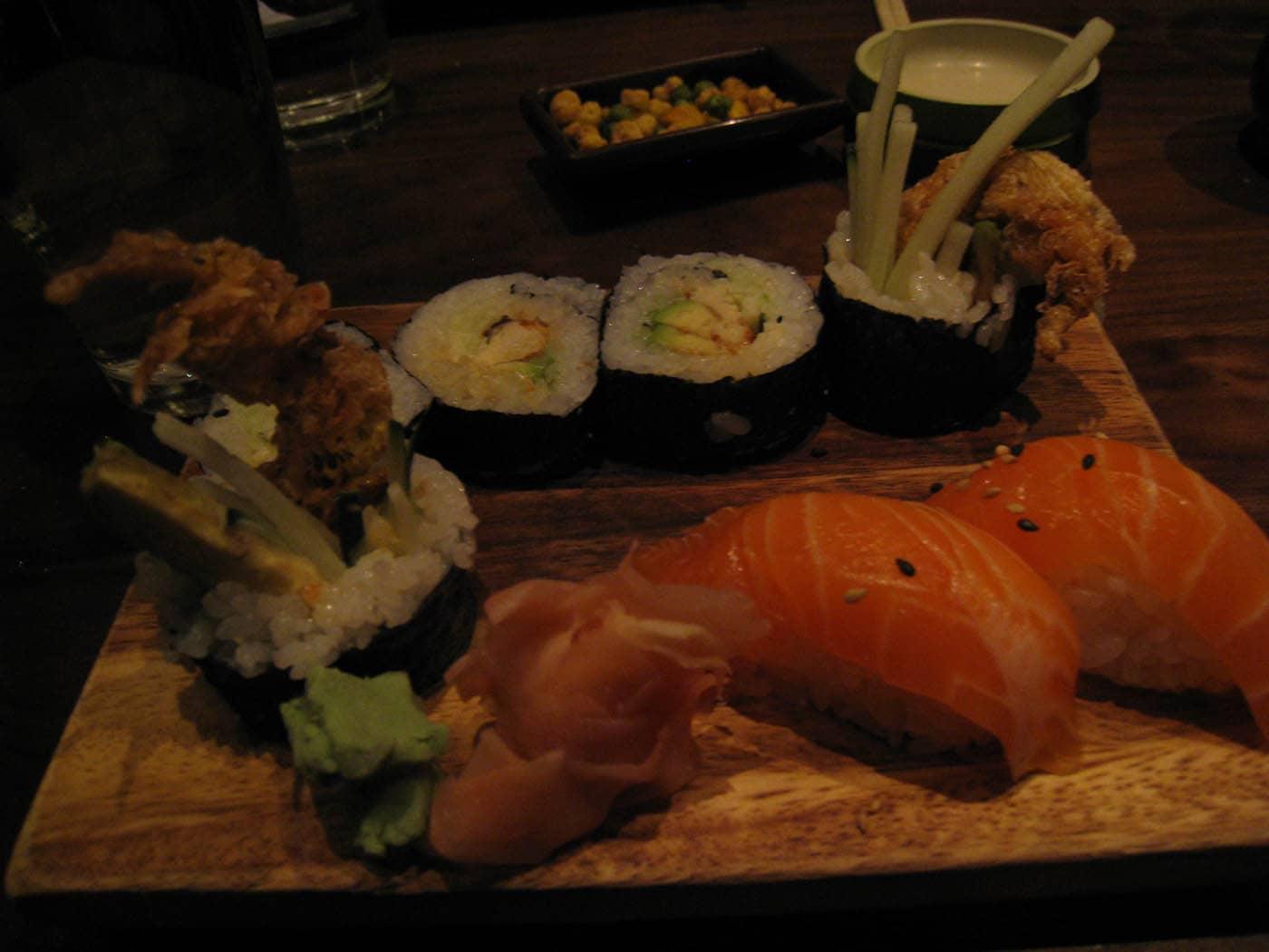 Soft shell crab maki and salmon nigiri. Sushi at Wakamono in Chicago, Illinois.