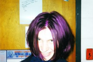 Dying my hair purple in my college dorm room.