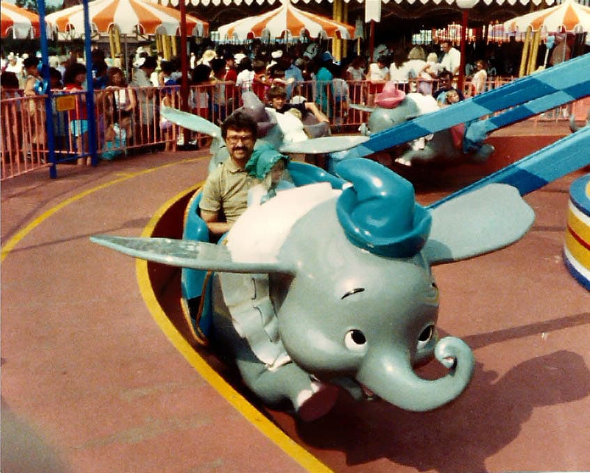 Dad and me at Disney when I was a kid.